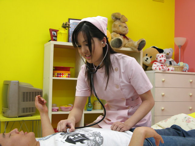 Lovely nurse Rio Nakumara makes it all better for horny cock Photo 9